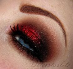 red- love the eye shadow but I HATE fake brows. That looks so stupid.
