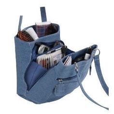 Denim Jean Purse Tote Bag- Interesting way to have an organized pocket book!Denim Jean Purse Tote Bag- the link is rotten - pinning because I love the… Cool shape (link is broken)**good idea**picture onlycommercial, not a pattern, but could devise somet Denim Handbags, Trendy Handbags, Tote Handbags, Purses And Handbags, Denim Jean Purses, Denim Bag, Recycled Denim, Fabric Bags, Handmade Bags