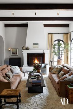 Kendall Jenner finds refuge in a serene Los Angeles home bathed in warm, neutral tones and organic textures. #shag #rug #texture #neutral #curtains #livingroom #fireplace #coffee #table #books #couch #custom #sofa #ottoman #pillows #tree #grey #paint #pottery #exposed #beams #linen #vintage Architectural Digest, Home Living Room, Living Room Designs, Living Spaces, Kendall Jenner House, Kylie Jenner Room, Casas The Sims 4, Celebrity Houses, Living Room Inspiration