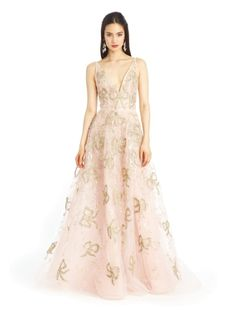 This is a sleeveless gown with  v neckline and gold bow detail embellishments. The bow embellishments on the gown is creative and exquisite. Bows are a feminine touch.