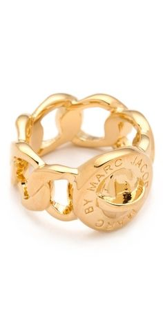 This gold-plated Marc by Marc Jacobs ring features logo lettering at the turn-lock detail.