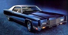 1971 Lincoln Continental Coupé shown in Dark Blue with optional White vinyl roof and White leather interior