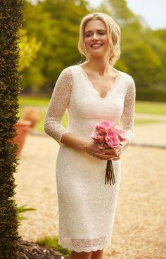 e7a0d9f2bb827 Anya Lace Wedding Dress Ivory by Alie Street. So demure, our impeccably  tailored empire line wedding dress falls to the knee in beautiful ivory  corded lace ...