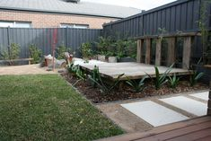 Rustic timber day bed.Just waiting for some comfy pillows. Garden design by RPGD www.rpgardendesign.com.au