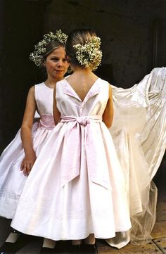 """""""Fantasy"""" an exceptional flower girl dress, optional color sash, pearl inserts throughout the collar line including the parted back. Isabel Garretón Special Occasion Collection"""