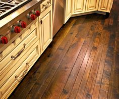 hand scraped hickory engineered.  Love this floor it looks similar to what I have in my foyer/living room.  I think hardwood floors look awesome in kitchens too!