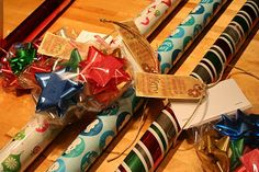 """Neighbor Gift, Christmas - wrapping paper & bows with a tag that says """"Hope you're getting all wrapped up in the spirit of the season!"""""""