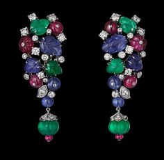 Image from http://www.jewelsdujour.com/wp-content/uploads/2013/10/Earrings-Platinum-sapphire-ruby-and-emerald-beads-sapphire-and-emerald-carved-leaves-brilliants..jpg.