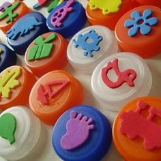 Handmade bottle cap stamp kit. Foam stickers on bottle caps + a stamp pad = hours of fun for kiddo.