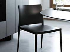 Absolute lightness of this chair featuring a light metal structure with four tapered, square sectioned legs combined with a seat Take A Seat, Minimal Design, Lighting Design, Soft Fabrics, Minimalism, Dining Chairs, It Is Finished, Contemporary, Furniture