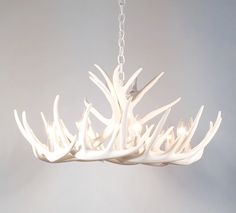 This is an all white antler chandelier made with faux reproduction antlers. Description from etsy.com. I searched for this on bing.com/images