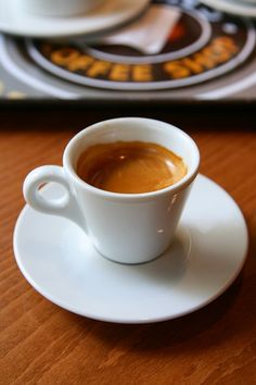 Strong coffee with crema in a white espresso cup. The best!!