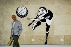 soccertronix:  A man walks past a street art caricature of Portuguese football player Eusebio at the Lisbon airport subway station, on July 17, 2012. Metro Lisbon inaugurated on July 16 three new subway stations on the red line connecting the center of Lisbon to the airport. TOPSHOTS/AFP PHOTO/PATRICIA DE MELO MOREIRA Football Love, Football Art, Lisbon Airport, Street Football, Places In Portugal, Soccer Art, Caricature, Graffiti, Street Art