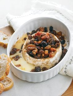 Baked Brie with Dried Fruit Appetizer—If we could make a meal of #appetizers we would. Try this baked soft-ripened cheese with dried fruits recipe for your next party.