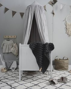 Gorgeous gender neutral baby nursery in grey tones http://petitandsmall.com/fall-love-gorgeous-grey-home/