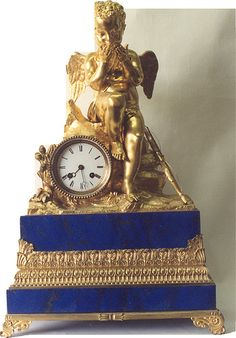 Bronze and lapis figural clock