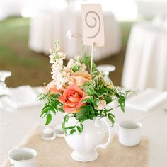 Romantic Pitcher Centerpieces maybe with a sea glass pitcher cute..