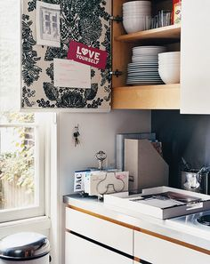 Treat Toast Racks as Mail Organizers and Line the Inside of a Cabinet with Fabric Covered Cork Board.