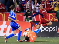 APRIL 4: Fabian Espindola #7 of Real Salt Lake has the ball taken from him by Goalie Donovan Rickets #1 of Montreal Impact as Jeb Brovsky #15 watches during the first half of an MLS soccer game April 4, 2012 at Rio Tinto Stadium in Sandy, Utah.