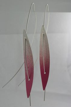 Marcin Tyminski's earrings (at AME gallery, Hong-Kong)-Sandblasted with prisma color maybe???