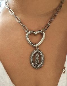 new sterling silver small tear drop pendant set with a single Amber cabochon stone on a 1.25mm chain
