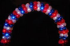 Simple air filled arch with Party Dots added. Great for balloon decor highlights.
