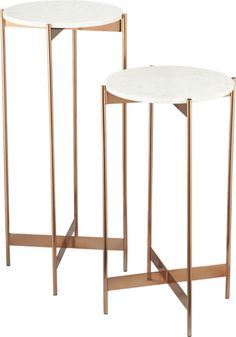 White marble floats effortlessly on svelte metal legs in elegant display ideally sized for art or botanicals.  Stainless steel base warms in rose gold lacquer with ridged cross-bar support. White marble topStainless steel base finished with rose gold lacquerClean with dry soft clothMade in India.