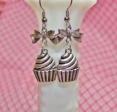 Cupcake bow earrings, silver cupcake earrings, gift for baker, cupcake lover, sweet, dessert, swirl, charming, dangle, charm, metal on Etsy, $9.00
