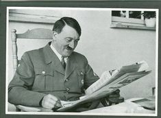 Hitler smiles while reading newspaper...don't read those newspapers full of lies, there is really nothing in it. (hm, maybe sport pages...)