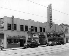 The Hollywood Theatre, located at 6764 Hollywood Boulevard, and neighboring businesses (ca. April1942)