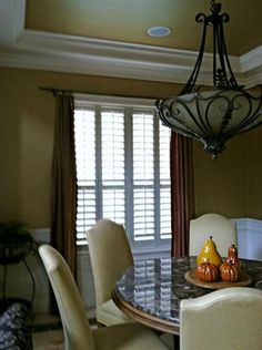 Mirasol poly plantation shutters by ShadesToYou in Orlando, FL. Beautifully layered look with drapery panels!