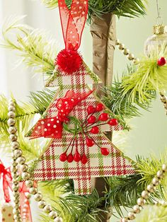 """""""Plaid Christmas Tree Ornament: Cover a chipboard tree shape with paper in a holiday plaid. Embellish the tree with small berries, a red pom-pom star, and sheer polka-dot ribbon, also used for a hanger."""""""