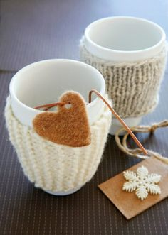 Lovenordic Design Blog: Some more Christmas inspiration from Norway.... Cute cozies, who do I know that knits, I might have to hit goodwill for some old sweater cuffs?