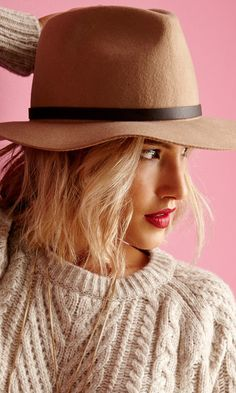 Wool felt Panama-style hat with faux leather band and buckle detail.