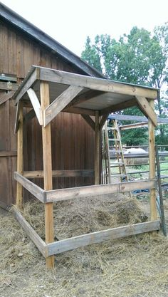 Covered hay feeder. Save hay from rain and weather. Scrap 2 by 6's and some tin is all you need.