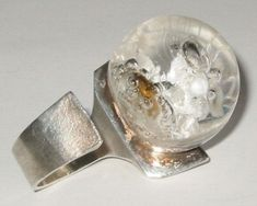 Bjorn Weckstrom - 'Petrified lake' ring, silver with acrylic, 1970s.