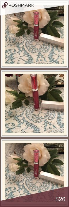 It Cosmetics Lip Gloss Stain This is called vitality lip blush hydrating lip gloss stain and the color is inspiring red.  It is filled with hydrating anti-aging collagen, peptides, hyaluranic acid, plum oil, cherry oil, shea butter avacoda oil, argan oil, jojoba oil, and antioxidants. It Cosmetics Makeup Lip Balm & Gloss