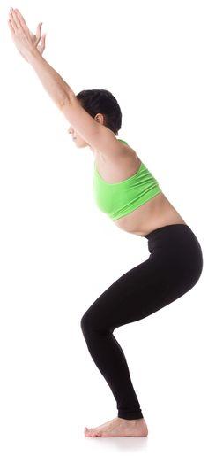 Sporty girl on white background standing in Chair yoga Pose (Fierce, Hazardous, Lightning Bolt, Wild, Awkward Posture), utkatasana, exercise for leg muscles