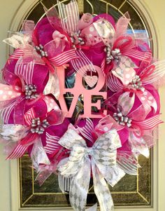A personal favorite from my Etsy shop https://www.etsy.com/listing/486628366/valentines-day-pink-deco-mesh-wreath