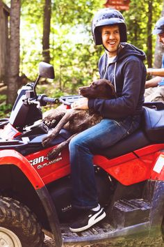 Sebastian Vettel and a dog on a four-wheeler. could this be anymore perfect?