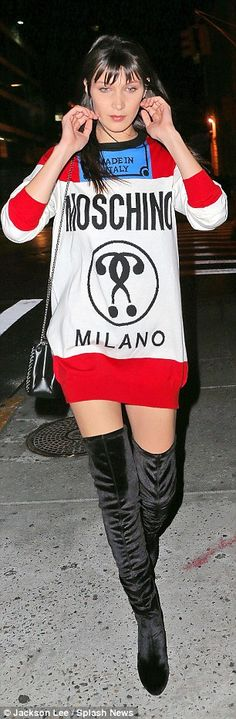 Smokin' hot! Looking stunning, the girlfriend of musician The Weeknd modelled a Moschino sweater dress designed by Jeremy Scott, which takes inspiration from the Marlboro cigarette packet