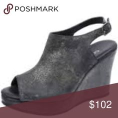Cordani Wellesley Wedge in Black Onyx Leather A wrapped wedge creates a chic profile of a paneled sandal cast in lusciously soft nubuck.   4 inch heel; 1 inch platform Adjustable strape with buckle closure Nubuck upper and lining Rubber Sole Made in the USA Cordani Shoes Wedges