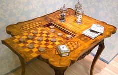 Table from around 1750 has a backgammon board under a chess/checkers/draughts board, and nine men's morris at the other end. Probably German. Photo by Thomas Quine