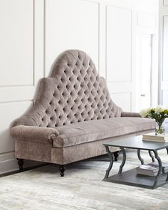 Handcrafted sofa. Tufted inside back; turned legs. Hardwood frame with hand-painted coffee bean finish. Cotton/acrylic/nylon upholstery; light amethyst is featured. Nickel nailhead trim along outside