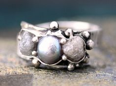 Raw diamonds and Steel Grey Pearl in textured sterling silver ring.