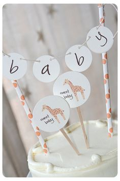 I am thinking I a can do the little circles or maybe in a bunting shape as Maksim's name then maybe have circles printed like this or a actual figurine giraffe
