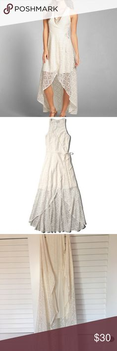 Abercrombie and Fitch white lace wrap front dress Gorgeous lace wrap front dress. Flowy and long. Very elegant and comfortable. Worn a few times but still in nice condition. Abercrombie & Fitch Dresses High Low