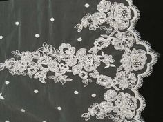 "Bridal Lace- Style #95302BP. 52"" Wide. 100% Polyester. Priced per 5 yard piece. Embroidered, beaded, and corded Schiffli Lace with a Single Scalloped Edge."
