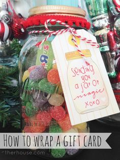 such a cute idea for giving gift cards. Mason jars, filled with candy and gift card in the middle. Clever!!