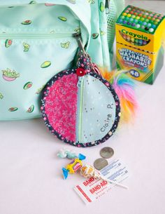 With Back-to-School just around the corner, I would like to share my quick and easy mini purse that can be attached to your kids' backpacks.  This is perfect for all of you who have huge stashes of scraps and not a lot of time. Fill it with some coins for a gumball machine and a bandage or a little toy that your kids want to carry with them all the time. This purse would make a perfect surprise for your little one on the first day of school! #sewing #mini #zip #zipper #pouch #purse #backpack